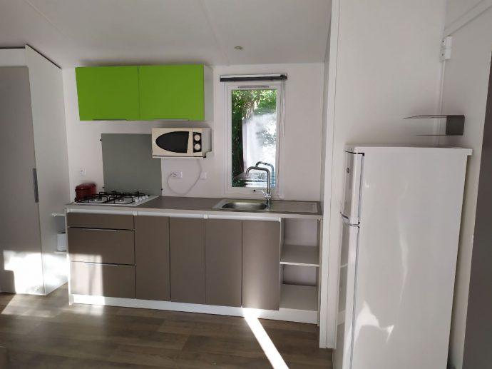 Photo du coin cuisine dans Mobilhome Camping Dordogne
